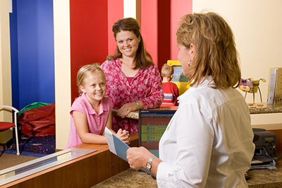 Child at Front Desk at the Pediatric Dentist Office in Gilbert, Mesa and Chandler, AZ